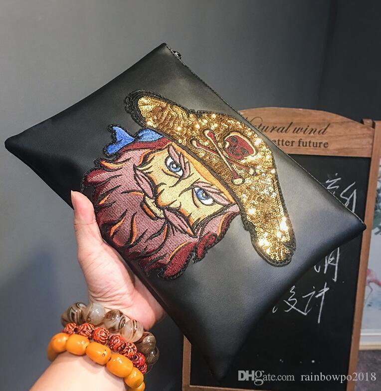 Factory outlet marke männer handtasche neue straße trend totem mode handgelenk tasche exquisite stickerei handtasche große leder aufbewahrungstasche