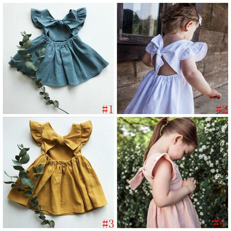 Baby-Kleidung für Kinder Zurück Bouknot A-Linie Kleider Baumwolle Leinen Rüschen Prinzessin Kleid-Sommer-Fly Sleeve Ferien Sundress Tutu-Kleid PY556