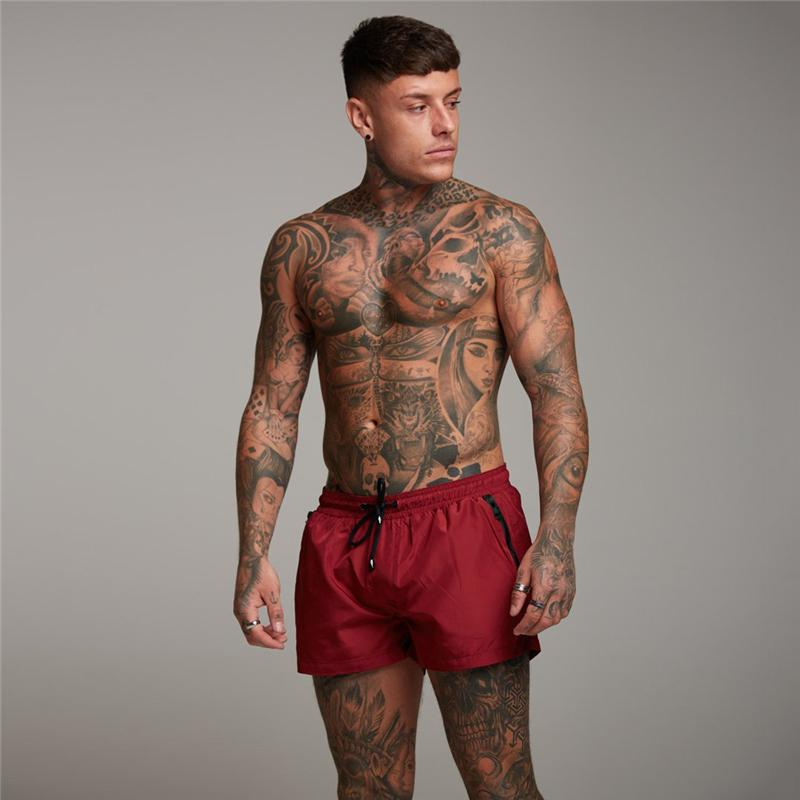 Nuovo Mens Fitness Bodybuilding short uomo estate di allenamento di ginnastica maschile solido asciutto rapido respirabile sportivo Jogger Pocket Zipper Beach Pantalone corto
