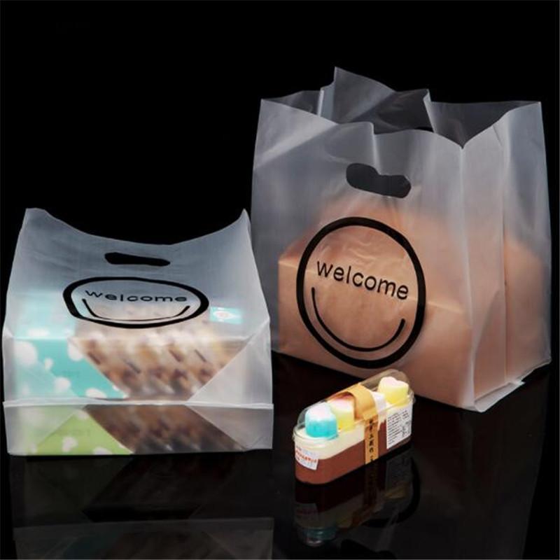 Presente Plastic 50pcs / Lot Bolsa de luxo jóias embalagens sacos de plástico sacos de compras com punho Bem-vindo bolsas Carry Present