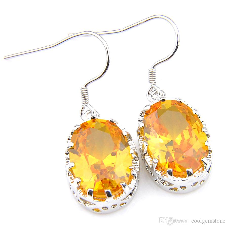 A PAIR OF AMBER CRYSTAL TEARDROP  EARRINGS WITH 925 SOLID SILVER HOOKS NEW..