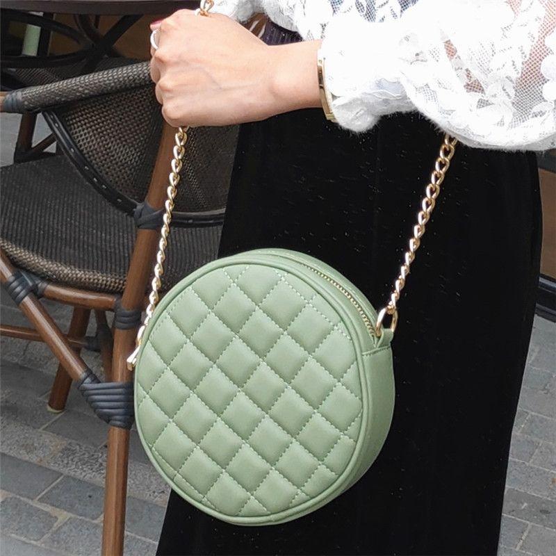 pequeñas y redondas de hombro de diamante de moda hombro de las mujeres de la cadena de rejilla Xiaoxiangfeng francesa bolsa inclinada bolsa de pastel redondo