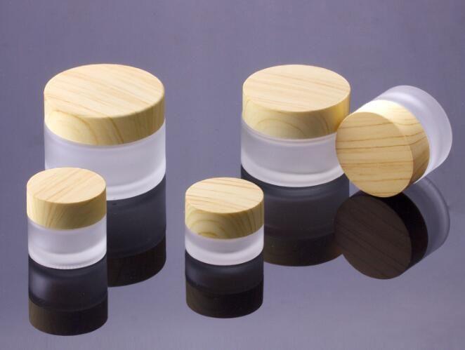 30pcs / lot 5g Mattglas Sahneglas mit Holzdeckel Make-up Hautpflegelotion Topf kosmetischer Behälter Verpackung Flaschen