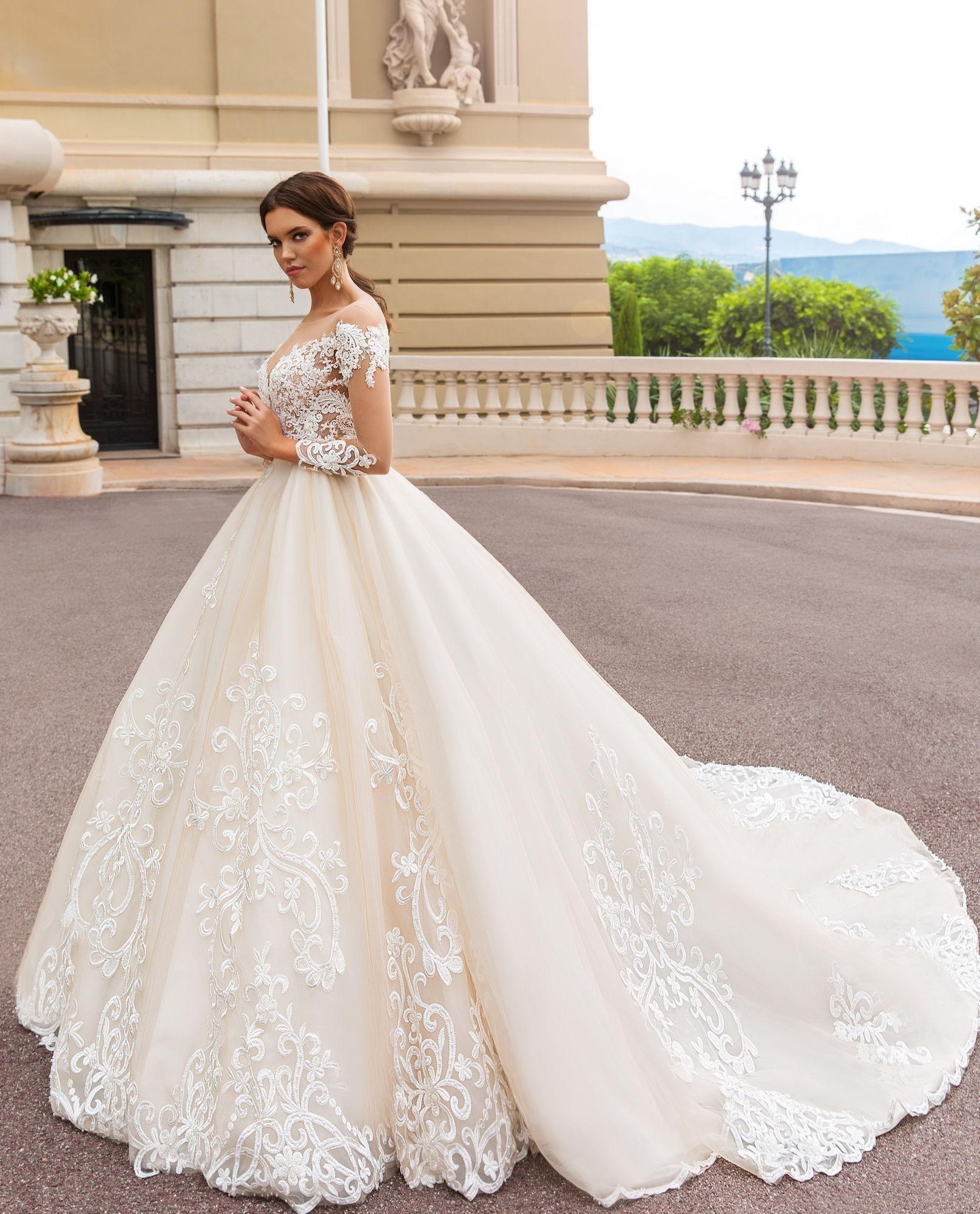 2019 Árabe Dubai Una línea Vestidos de novia Equipo Cuello Cuello Apliques Illusion Sheer Back Abrir Mangas Largas Capilla Tren Tallas grandes Vestidos nupciales