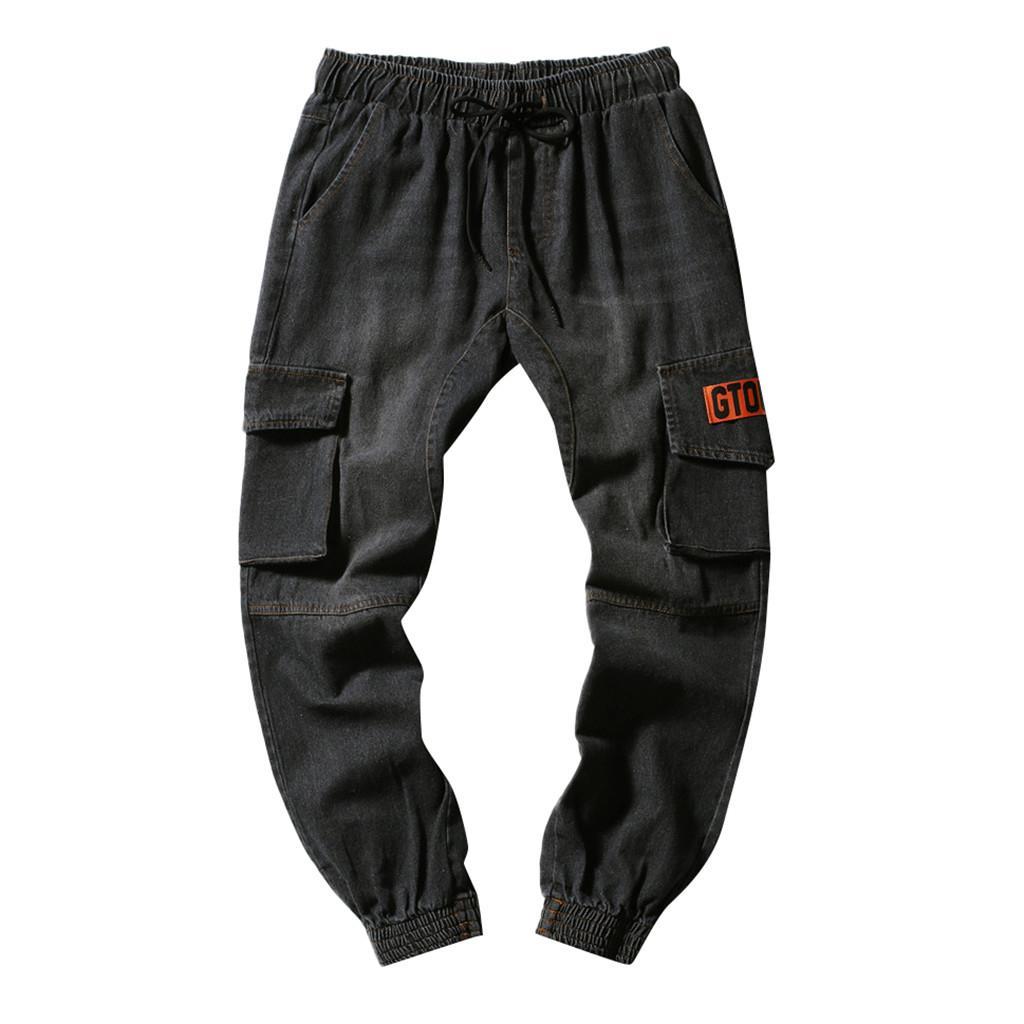 Los pantalones vaqueros de Carga mela Streetwear hombres Niza Multi-bolsillo Pantalones vaqueros elásticos de la cintura del lazo de la cadera Harem Hombres Trajes