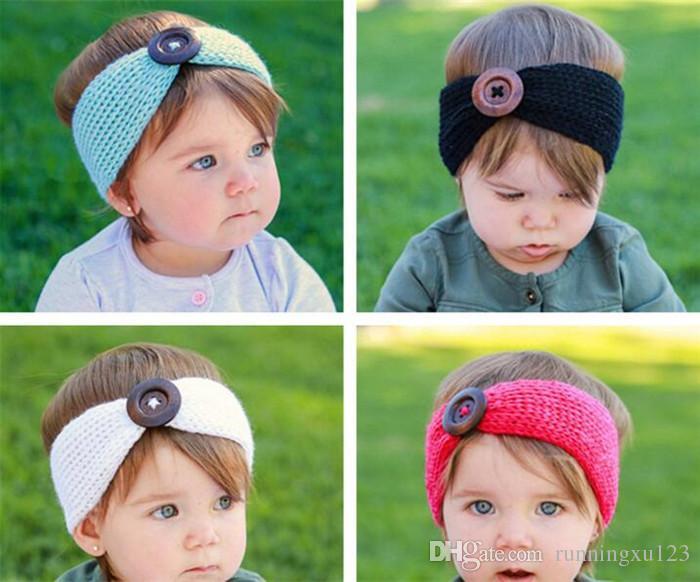 Neue Baby-Mädchen-Art- und Weisewollhäkelarbeit-Stirnband stricken Hairband mit Knopf-Dekor-Winter-neugeborenen Säuglingsohr-Wärmer-Kopf Headwrap R075
