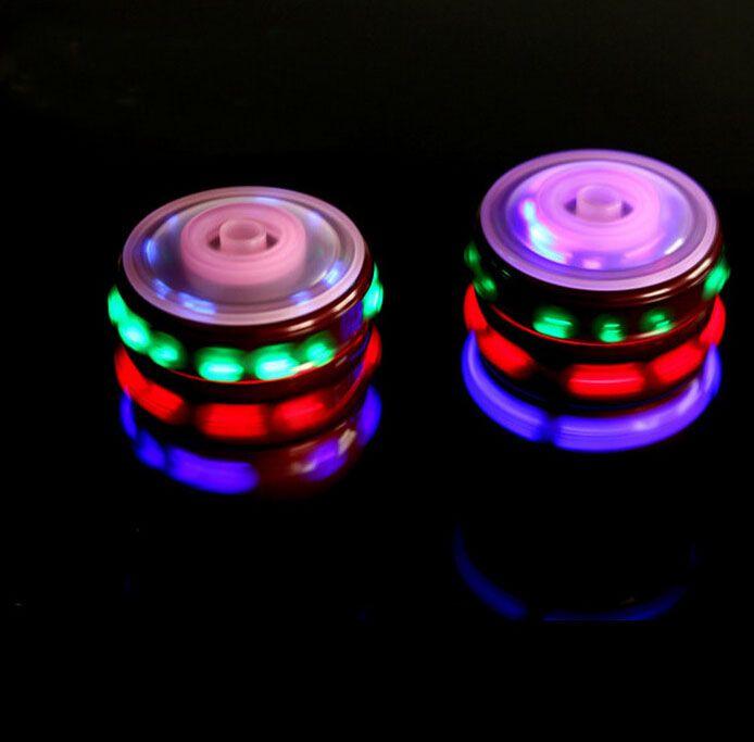 Красочные светодиодные спиннинг топ игрушка лазерная вспышка света спиннинг топы Spinner музыка песня взбивания топ детские игрушки подарки бесплатная доставка