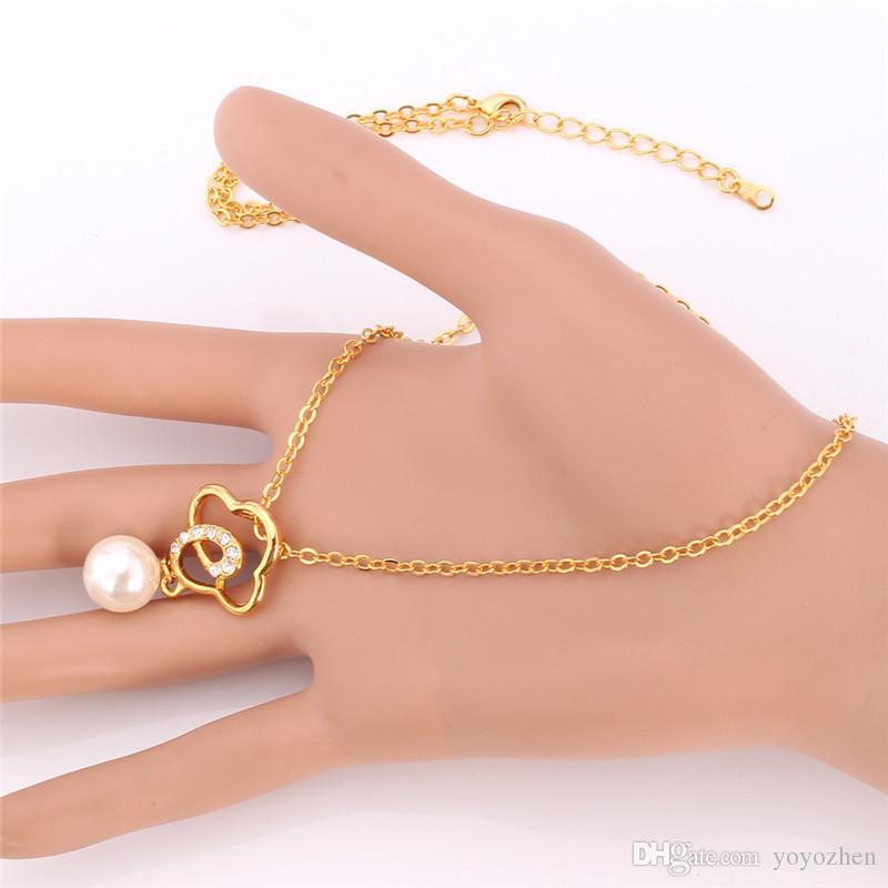 Di alta qualità 18 k placcato oro nuvola pendente collana girocollo set di gioielli con strass rosa perle finte all'ingrosso YS2410