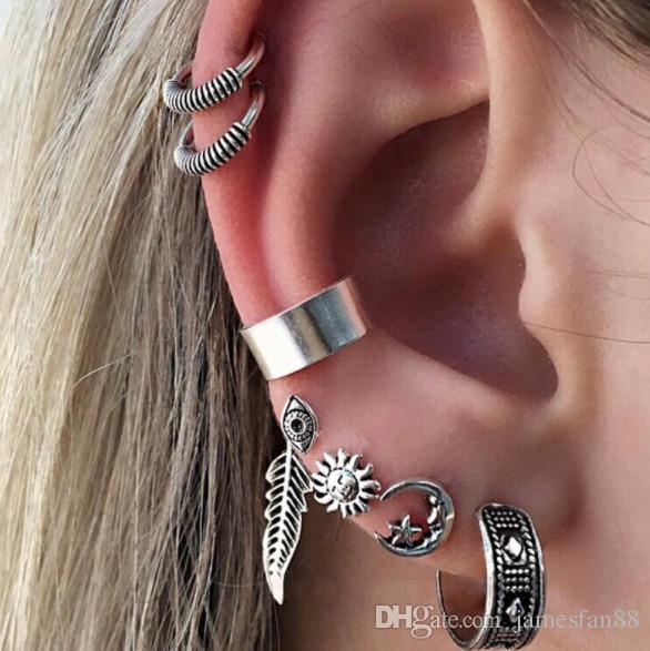 Orecchini del polsino dell'orecchio del fiore dell'annata più nuova della Boemia Orecchini antichi della vite prigioniera della mano del Buddha dell'argento tibetano antico della foglia Orecchini di Hamsa delle mani
