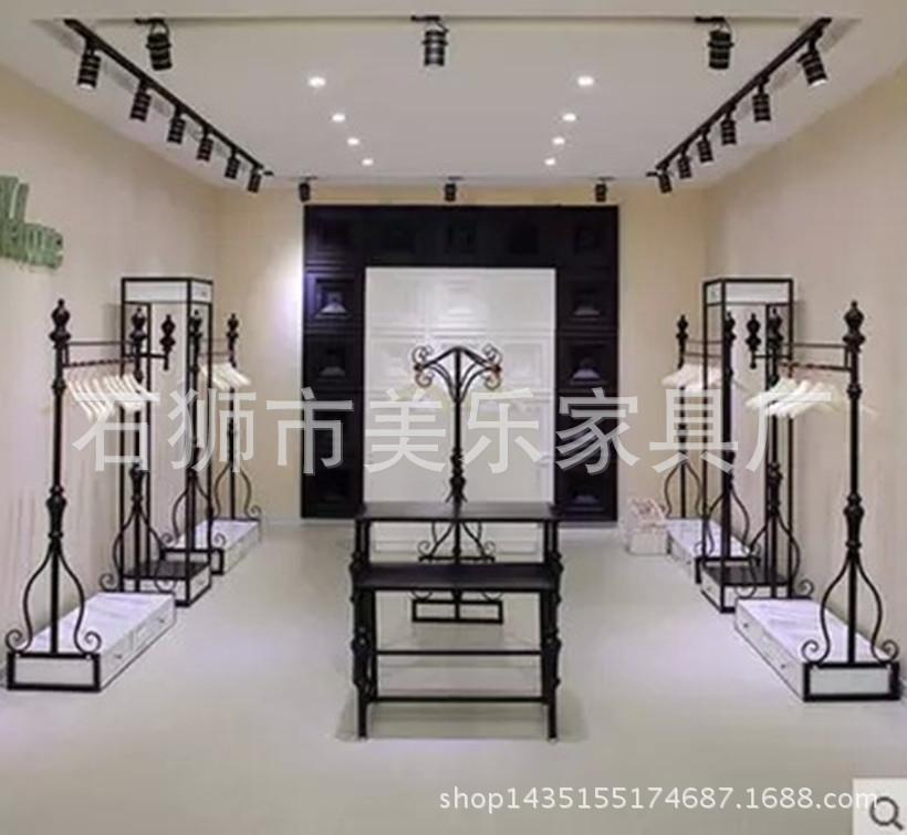 4ad9402fff0 Women s clothing store boutique shelves display clothing rack side  floor-wrought iron wall hanging display racks in the island w