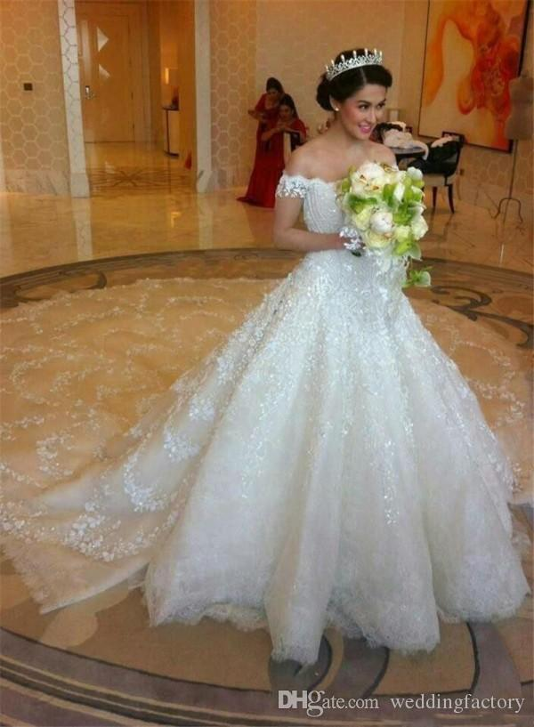 Luxury Dubai Wedding Dress A Line Off the Shoulder Beaded Lace Appliques Cathedral Train Bridal Gowns Illusion Back Expensive Handwork