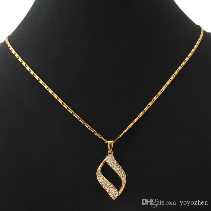 Vintage Scroll Clear Austrian Rhinestone Colgante Pendientes gargantilla Colgante Joyas de moda chapado en oro Juego de joyería para mujer YS732