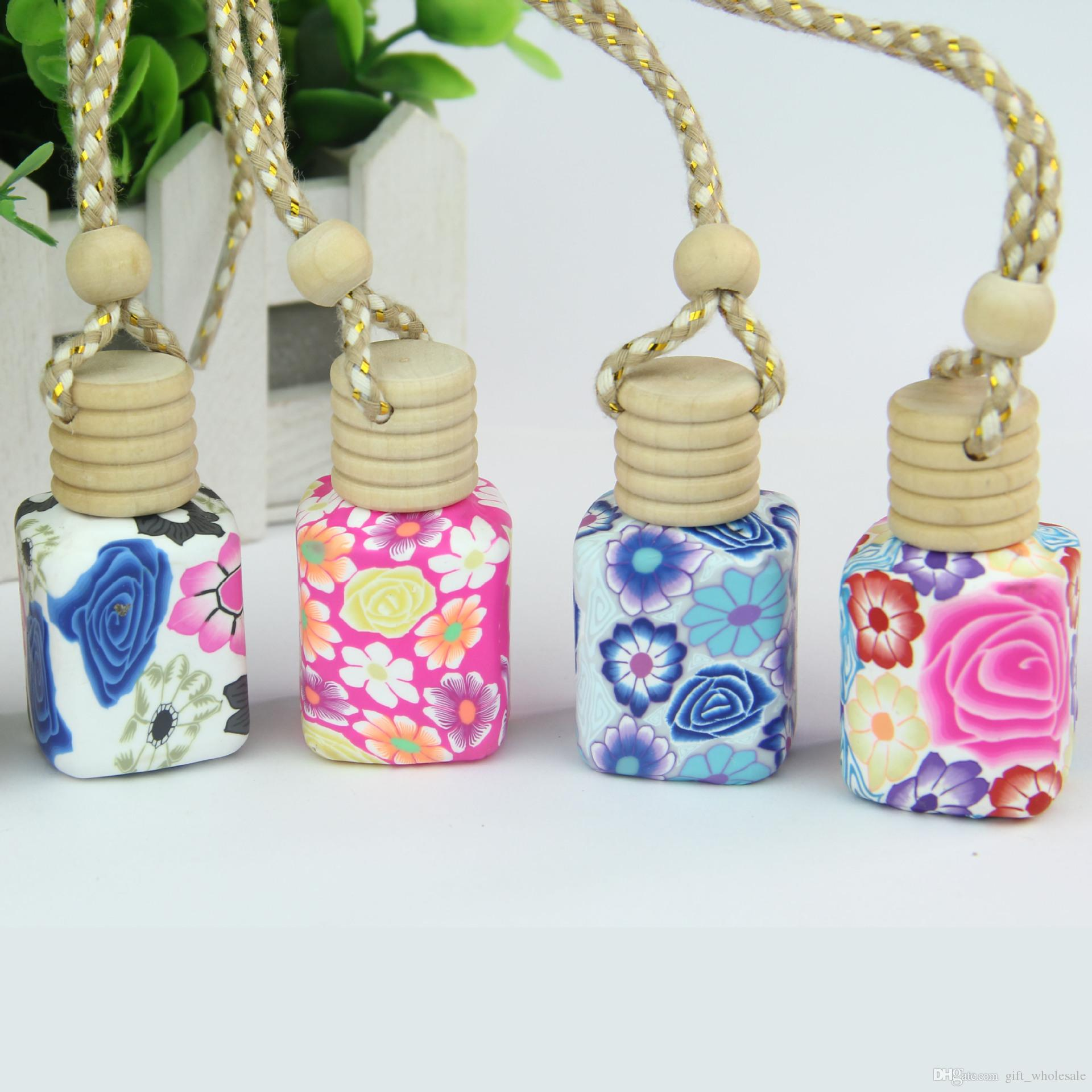 Envío gratis 12-15 ML colgar del coche decoración de esencia de cerámica botella de Perfume colgante cuerda botella vacía, 100 unids / lote