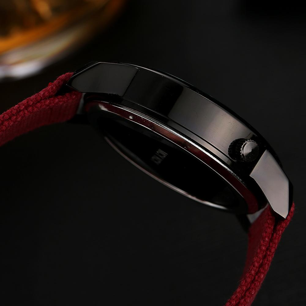 USA Damenuhren Mode Fünf-Punkte Stern Hohluhr Leinwand Geflochtene Riemen Big Red Dial Neutral Kleid Armbanduhr