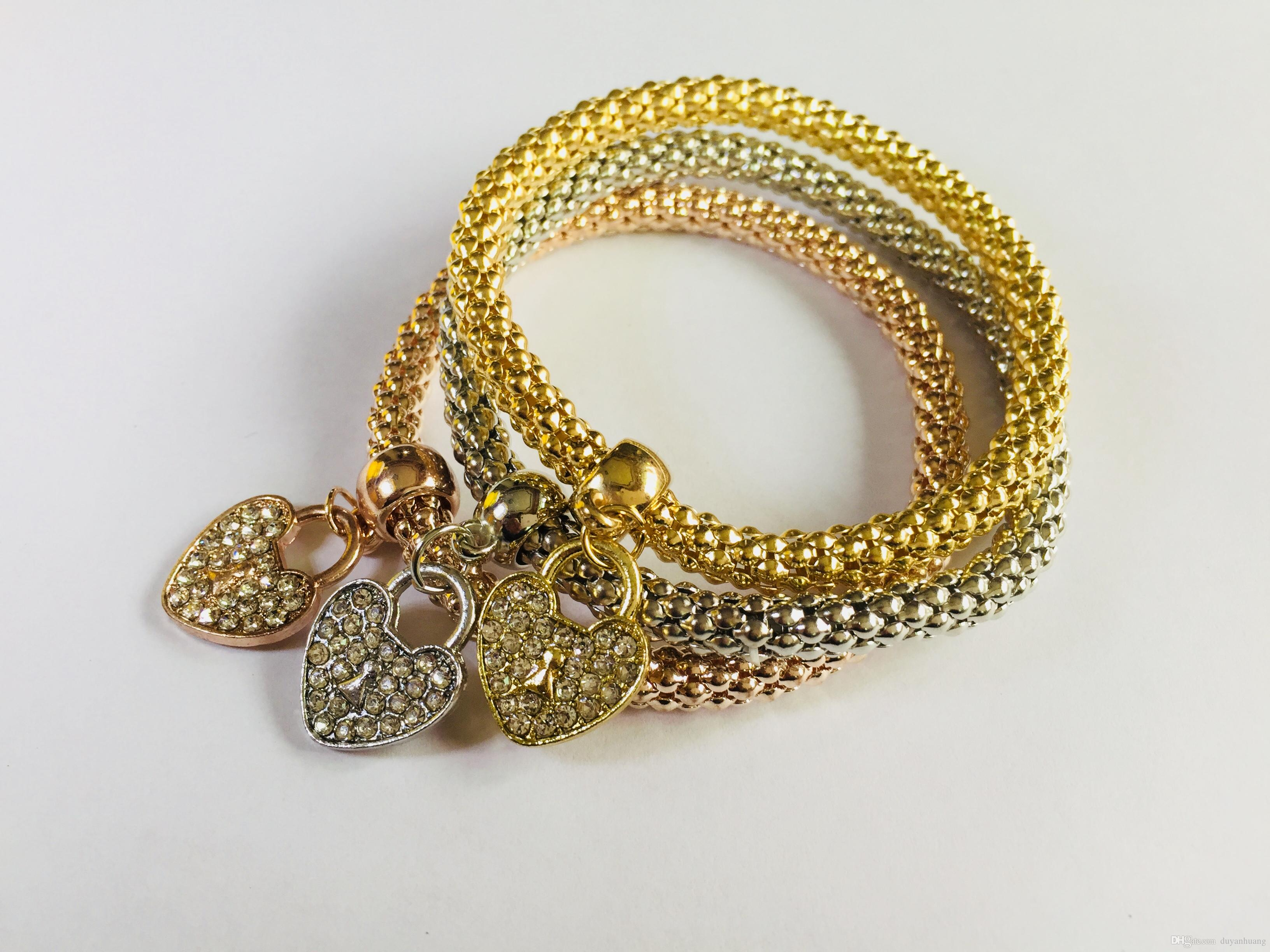 gold yellow jewellery in heart mondier bracelet with charm toggle jewelry