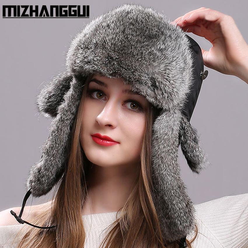 c32129b2813 2019 Wholesale Winter Women Men S Hats Natural Rabbit Fur Bomber Hat With Ear  Flaps Waterproof Cloth Tops Russian Warm Fur Hats For The Winter From  Glioner