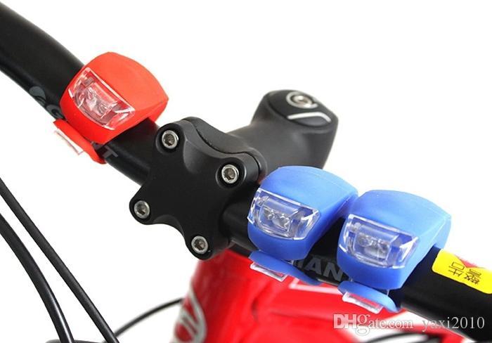 Silikon Fahrrad Fahrrad Radfahren Kopf vorne hinten Rad LED Flash Fahrrad Licht Lampe schwarz / rot enthalten die Batterie Kostenloser Versand
