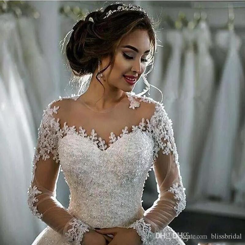 .2017 Neue Dubai Elegante lange Ärmel A-line Brautkleider Sheer Crew Nacken Spitze Applikationen Perlen Vestios de Novia Brautkleider mit Knöpfen