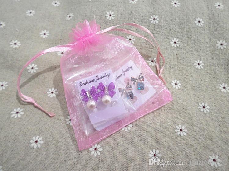 Livraison gratuite avec numéro de suivi Nouvelle mode mariage faveur organza pochette pochette cadeau bijoux 12 couleurs 7 * 9 cm 1461