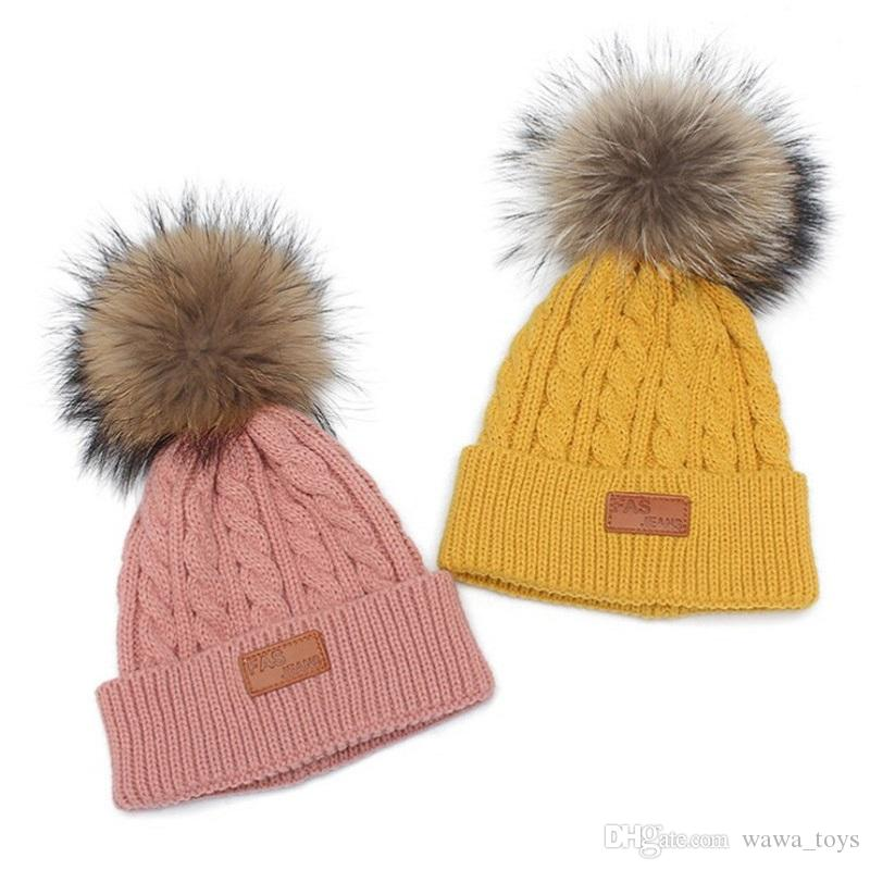 Fur Hat Kids Ball Pom Pom Cap Kids Winter Baby Girls Boys Winter Knitted  Wool Hats Caps For Infant Beanies Cute UK 2019 From Wawa toys 29313db2436