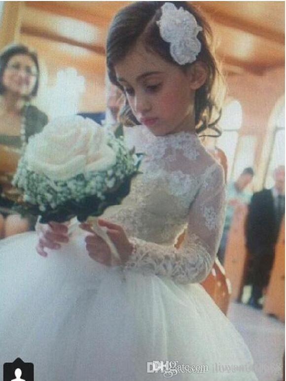 Vestidos de novia de la princesa 2015 de la pequeña niña de las flores con las mangas largas del cordón escarpado Vestidos del desfile del cuello alto Vestido de la primera comunión blanca