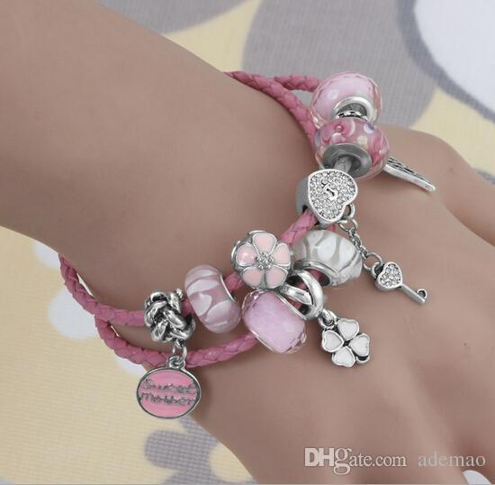 La nouvelle corde de main en alliage de bricolage perles roses ailes coeur de pêche bracelet en cuir multicouche LB014 pour le style européen populaire Gepanduola