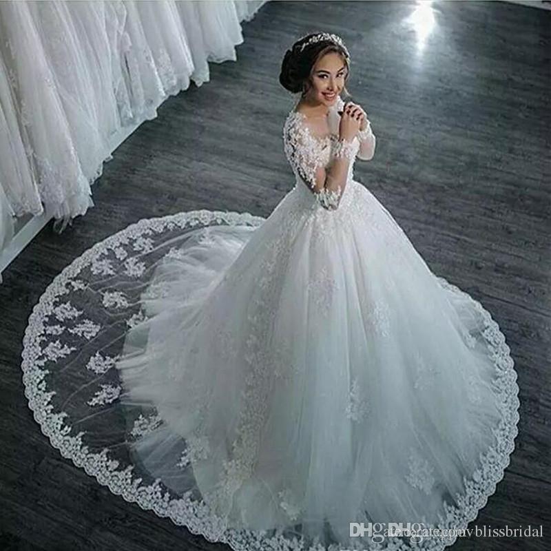 .2017 New Dubai Elegant Long Sleeves A-line Wedding Dresses Sheer Crew Neck Lace Appliques Beaded Vestios De Novia Bridal Gowns with Buttons