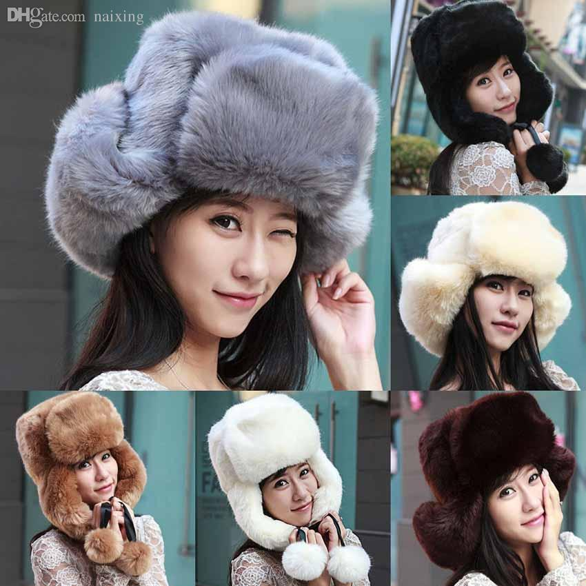 fa4643eb6f5 2019 Wholesale 2015 Womens Winter Warm Faux Fur Bomber Hats Ushanka Russian  Style Cossack Trapper Hat Ski Cap From Naixing