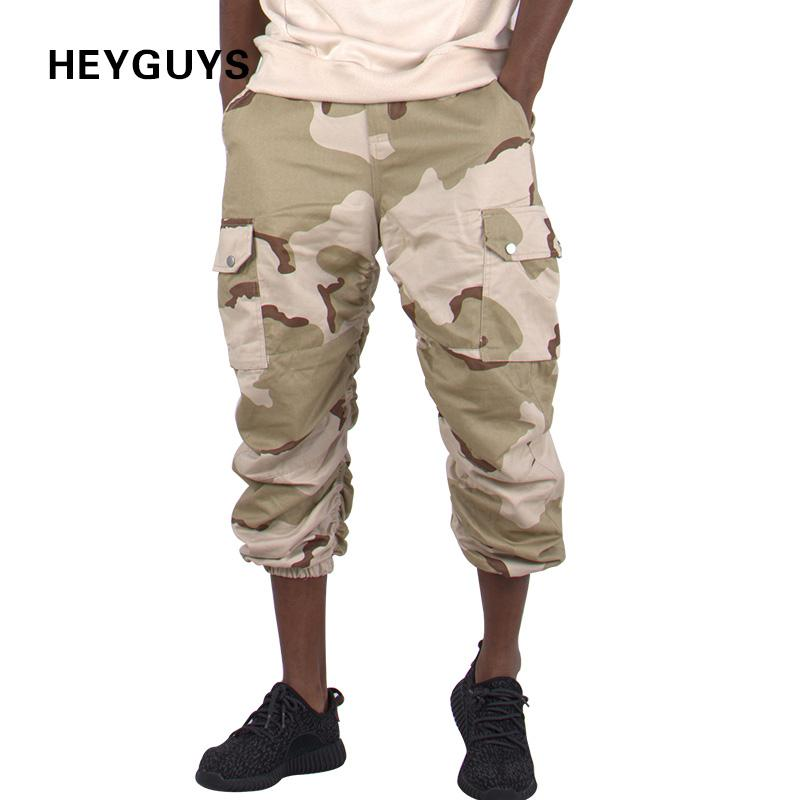 bcb0d28959e 2019 HEYGUYS Fashion Camouflage Pants Men Kaki Black New African Clothes  Hip Hop Street Jumpsuit Camo Cargo Loose Men S Tracksuits Q17118 From  Shen8408