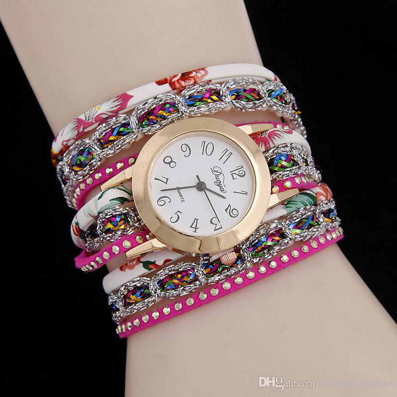 The new fashion bracelet watch winding female discus ms candy color silver belt quartz watch