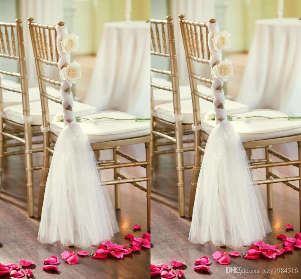 White tulle chair sashes handmade flowers criss cross for Table and chair decorations for weddings