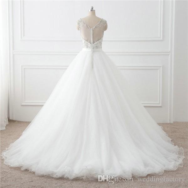 Sparkly Brautkleider A Line Sheer V-Ausschnitt ärmellose Perlen Top Illusion Zurück Pailletten Tüll Bling Bling Brautkleider