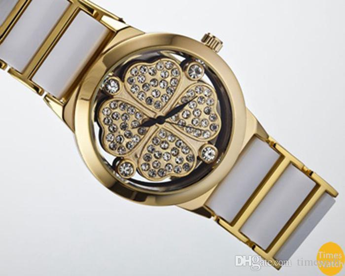 Новое прибытие женщины мода платье Марка Кварцевые наручные часы дамы случайные плоские марлевые золотые часы же звезда