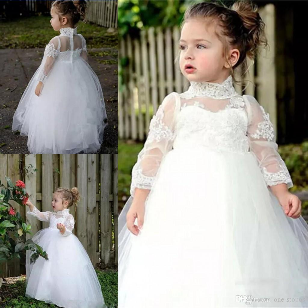 Acquista Abiti Da Ragazza Vintage Bianco Fiore Matrimoni Collo Alto Maniche  Lunghe In Pizzo Baby Abiti Prima Comunione Tulle Piano Lunghezza Toddler  Pageant ... a3352cbf48a