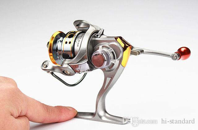 HOT 12 + 1BB DC150 Mini carretes de pesca Carretes giratorios L / R Intercambio de manos 5.2: 1 Mini carretes Gapless rodamiento Metal Reel ¡Alta calidad!