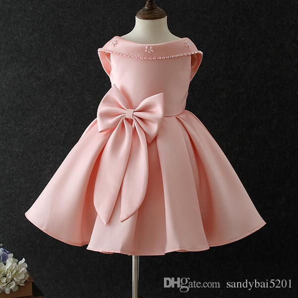 c1835caa9d82 2019 Party Dress Kids Girl Pearl Backless Dresses 2 9Year Princess Baby Girl  Big Bow Tutu Dress Costume 2018 Children Clothes D93 From Sandybai5201