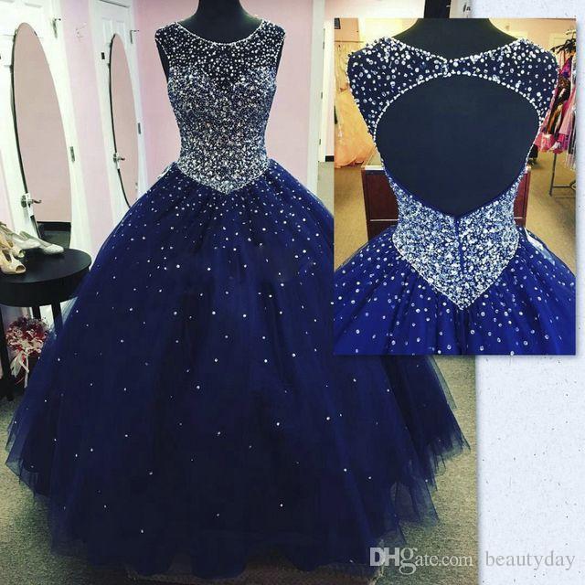 Abiti da ballo blu scuro scintillanti modesti Abiti da quinceanera Masquerade 2019 Sheer Neck Open Back Bling Crystal Pageant Dresses For Sweet 16