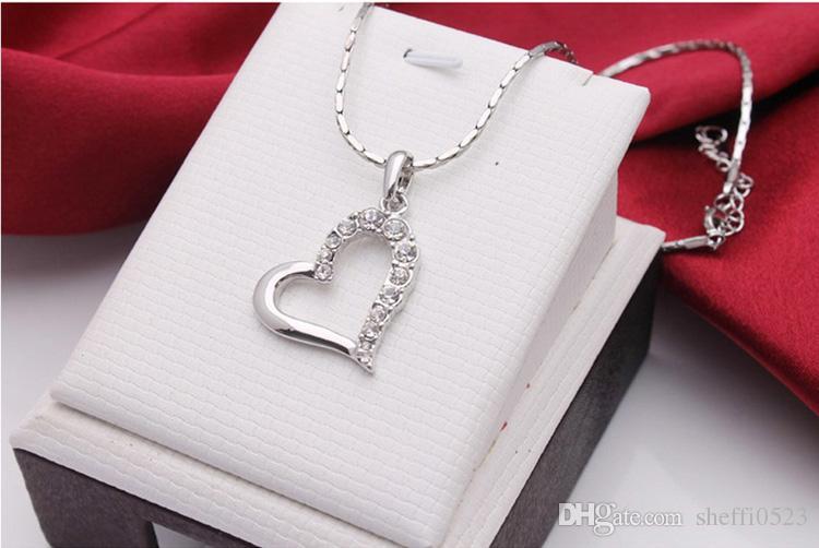 Corazón de la manera Collar de cristal Pendientes Conjuntos de joyería para mujeres Mejor regalo Simple personalidad de la novia Sistemas de la joyería 1247-80