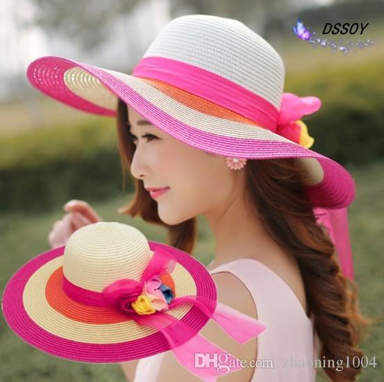 de586ddceefcf8 Elegant Big Straw Beach Flower Hats With Bow Ladies Wide Brimmed Vietnam  Floppy Foldable Sun Hat Women Caps UA Protection Summer Sun Visors  Fascinator Hats ...