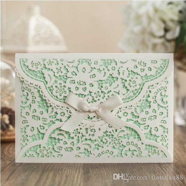 mint white flower wedding invitation with envelope ribbon laser cut