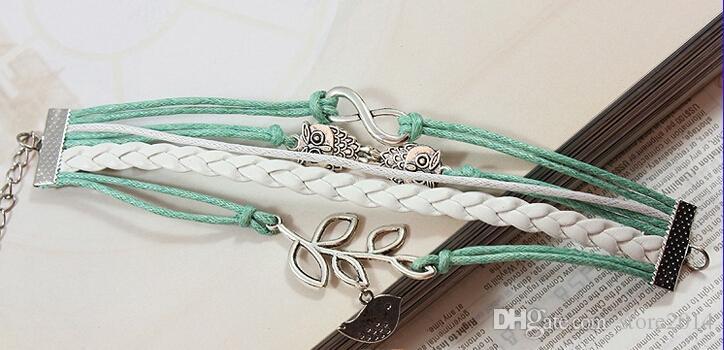 Nuovi gufi Infinity unisex Lucky Branch / Leaf e Lovely Bird Charm Bracelet in argento - Verde menta Cordoncini di cera e treccia di cuoio