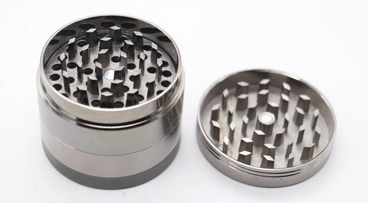 2015年の熱い販売ハーブメタルグラインダー4部の硬い上のタバコのグラインダーの直径50mmグリンデタバコ亜鉛合金クランクハーブグラインダー