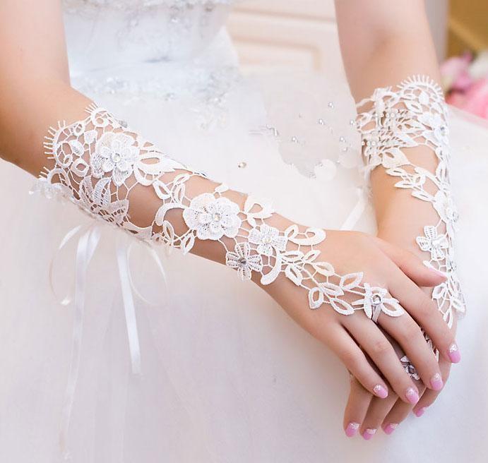 Nuovo arrivo 2019 accessori da sposa primavera guanti da sposa in pizzo bianco senza dita guanti da sposa economici prezzo all'ingrosso