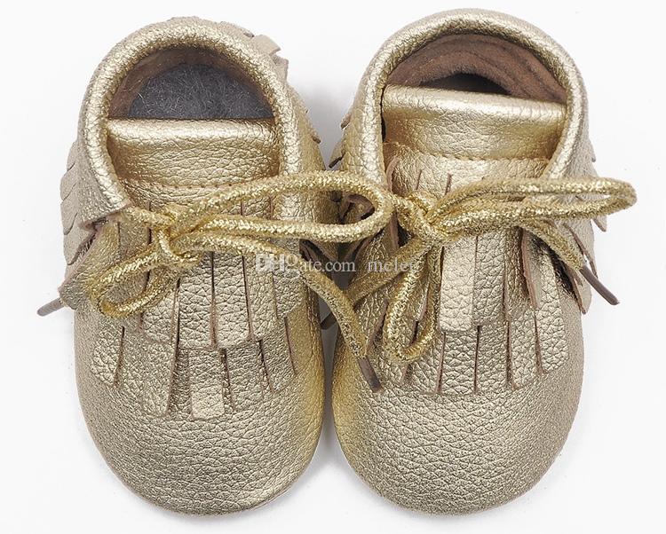 Gratis FedEx Ship Cow Läder Baby Moccasins Tassels Boot Booties Moccs Spädbarn Flicka Boy Lace Läder Skor Prewalker Booties Toddlers Skor