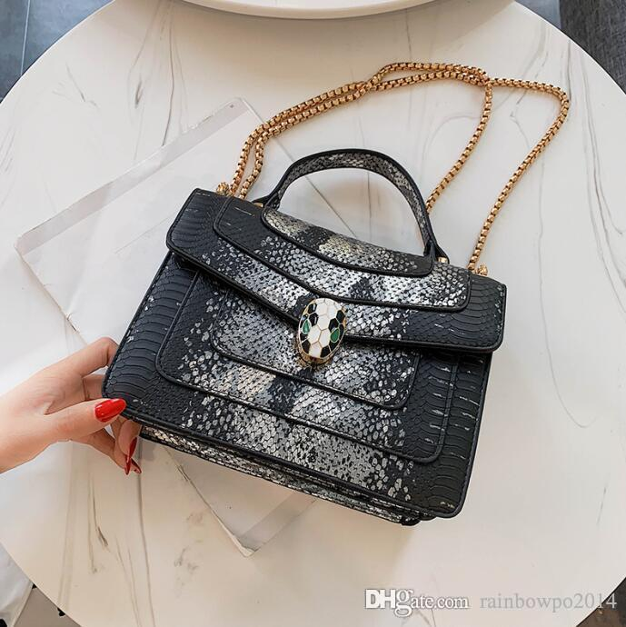 Factory sales brand women handbag new serpentine leather handbag personality snakehead lock chain bag foreign color contrast leather sho