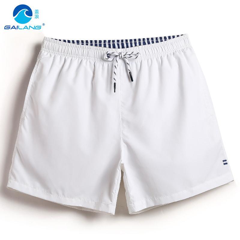 foto ufficiali f1b13 1c887 Gailang mens costume da bagno pantaloncini bianchi tinta unita costumi da  bagno uomo fodera in mesh fodera boardshort spiaggia surf praia de sungas  ...