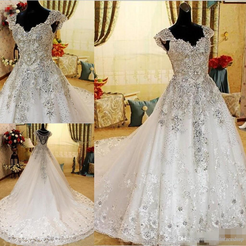 cdefc5dd8c Discount 2019 Hot Luxurious Crystal Beaded A Line Wedding Dresses Romantic Cap  Sleeve Tulle Lace Applique Long Women Bride Dresses Top Of The Line Wedding  ...
