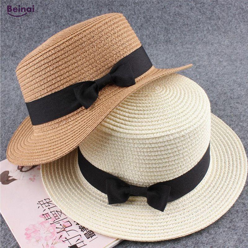 b9b914f6933eb 2019 Beinai Fashion Waterproof Sun Hats Woman Boater Beach Caps Bowknot  Flat Straw Beach Hat Sunshade Straw Dome Hats Man From Cbaoyu