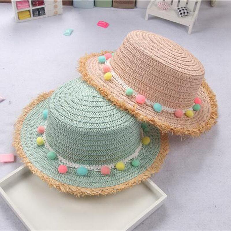 Compre 2018 Niño Verano Panamá Sombreros Para El Sol Colorido Borla Bolas  Sombrero De Paja Chica Floppy Ancho Ala Playa Gorro Sombreros D19011106 A   15.08 ... 391e988367e