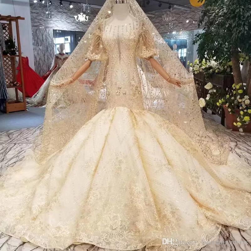 Mermaid Wedding Dress With Wedding Veil Illusion O Neck Lantern Sleeves  Open Back Trumpet Bride Gowns Golden Glitter 2019New Wedding Dress Designer  Gowns ... 754292d217f9